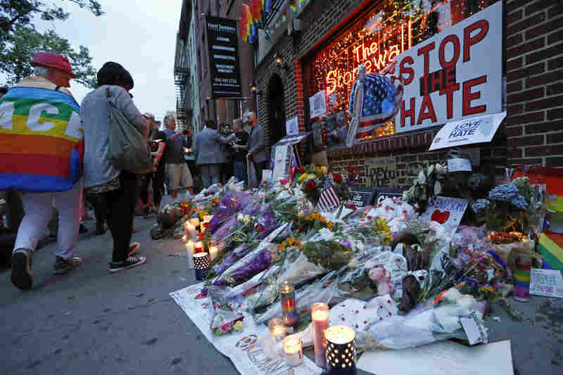 "In New York, scores of people gathered outside the Stonewall Inn, the site of a 1969 police raid that launched the modern gay rights movement. Mayor Bill de Blasio said the attack in Orlando was not just an attack on 49 Americans. ""It was an attack on American values,"" he said."