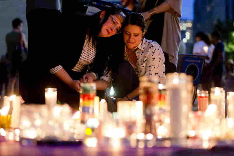 Mourners gather at City Hall in Philadelphia. Vigils were held in New York, Vermont, Florida, California, Alaska, Rhode Island, Colorado, Louisiana, Nevada, Ohio, Oregon, New Mexico, Pennsylvania and in Washington, D.C.