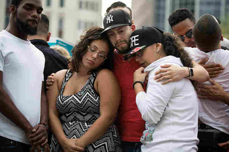 People flocked to a makeshift memorial in Orlando ahead of Monday night's vigil, which included a performance from the Orlando Gay Chorus.