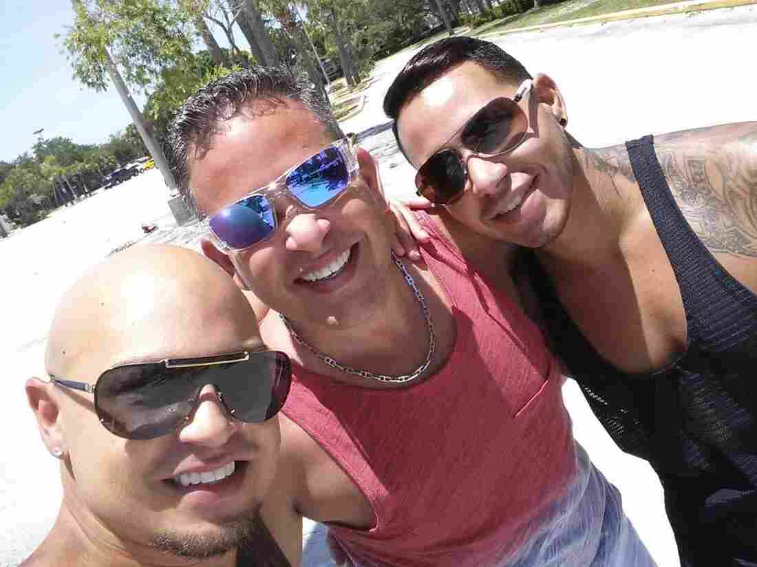 Luis Mercado with his friends Luis Conde, left, and Juan Rivera, right. Mercado spent hours after the shootings searching for his friends in hospitals, only to find out both had been killed in the shooting.