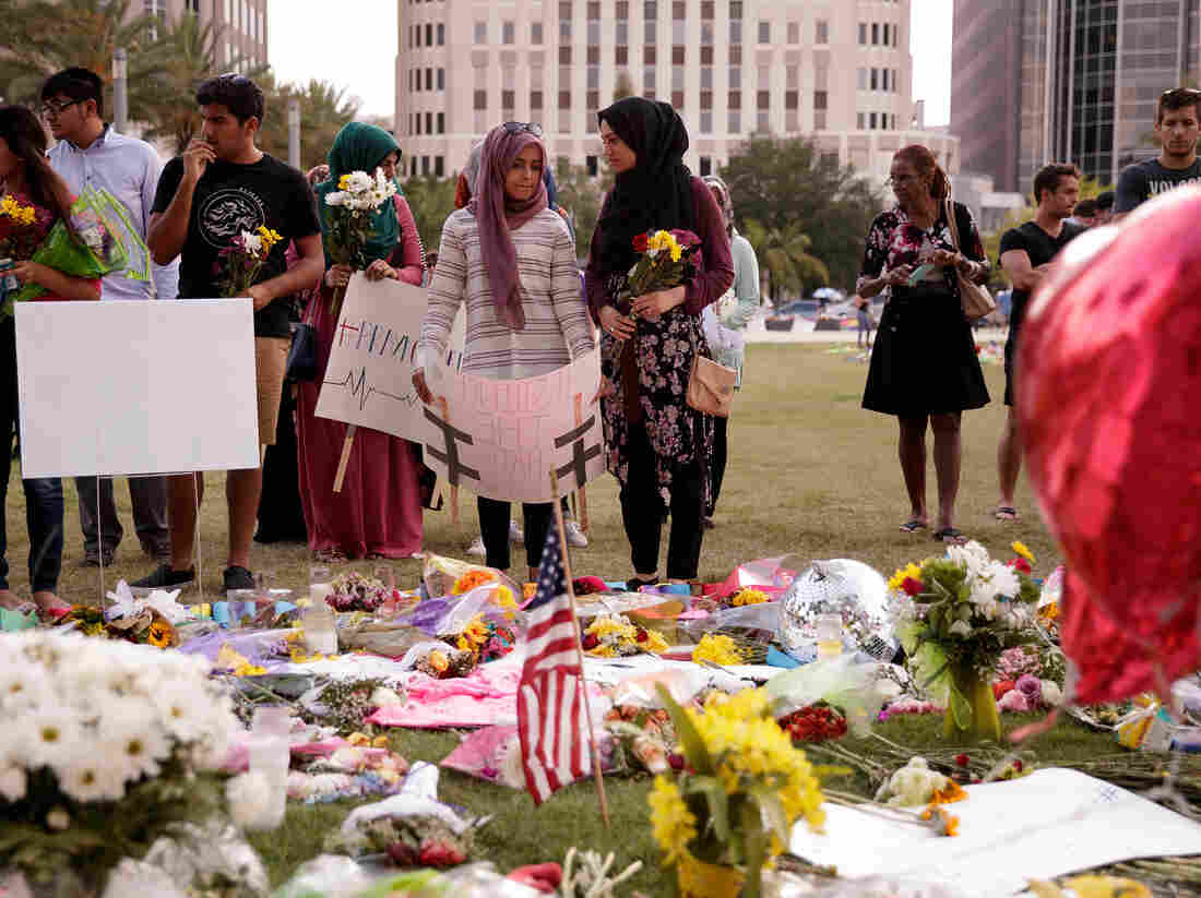 Young people from Husseini Islamic Center in Sanford, Florida visit a makeshift memorial at the Dr. Phillips Center for Performing Arts, June 14, 2016 in Orlando, Florida.