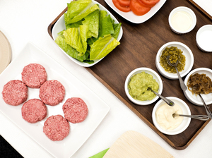 Silicon Valley-based Impossible Foods has taken a high-tech approach to creating a plant-based burger that smells and tastes like real meat. At the company's headquarters in Redwood City, Calif., chef Traci Des Jardins served the Impossible Burger (pictured uncooked) with vegan mayo, Dijon mustard, mashed avocado, caramelized onions, chopped cornichon, tomato and lettuce on a pretzel bun.