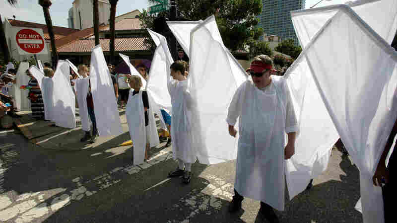 'Angels' From Orlando's Theater Community Guard Mourners From Protesters
