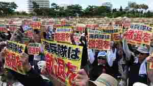 "Demonstrators hold placards that read ""Withdraw Marine Corps"" during a rally against the US military presence in Naha, Okinawa prefecture on Sunday, following the alleged rape and murder of a local woman by a former U.S. marine employed on the U.S. military base."