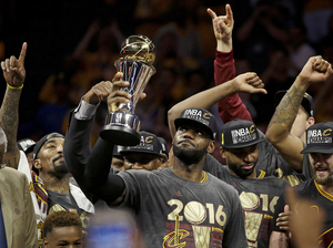 The Cleveland Cavaliers' LeBron James celebrates with teammates after winning Game 7 of the NBA Finals against the Golden State Warriors in Oakland, Calif., on Sunday.