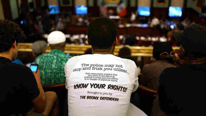 A critic of the New York City Police Department stop-and-frisk policy wears a shirt outlining a citizen's search rights at a City Council meeting in August 2013. The Supreme Court ruled Monday in an unrelated case that even if police stop someone without cause, if a reason is then found to search them, any evidence collected is admissible in court.