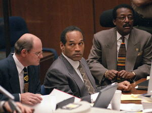 O.J. Simpson sits with his attorneys Johnnie Cochran Jr. (right) and Robert Blasier (left) during a court hearing in the O.J. Simpson murder trial.