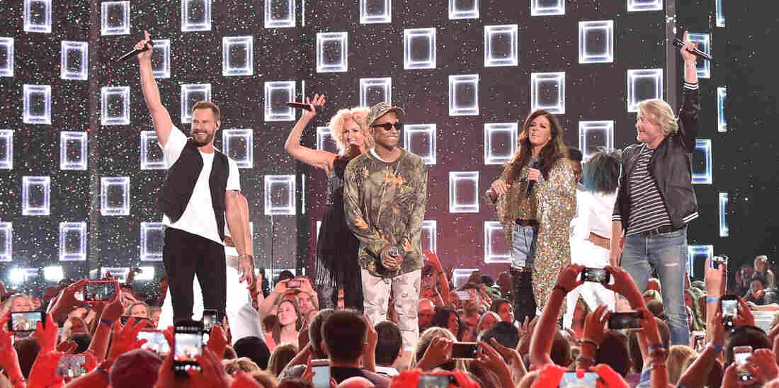 The members of Little Big Town with producer Pharrell Williams, who produced the group's new album, Wanderlust.