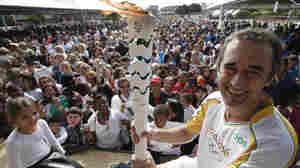 Marcelo Barreto holds the Olympic torch in Bicas, Brazil, as part of the Olympic flame relay on May 16. The first-ever Summer Games in South America begin Aug. 5 in Rio de Janeiro.