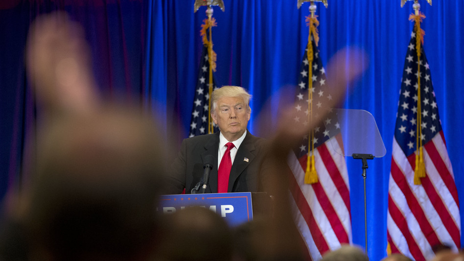 A supporter claps as Republican presidential candidate Donald Trump speaks in New York on Wednesday. (Mary Altaffer/AP)