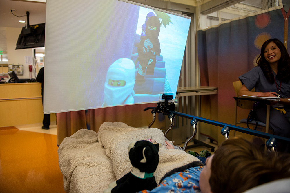 Kids waiting for surgery at the hospital can choose from a menu of age-appropriate entertainment options that include certain TV shows, movies and music videos. The big, close screen helps make the experience
