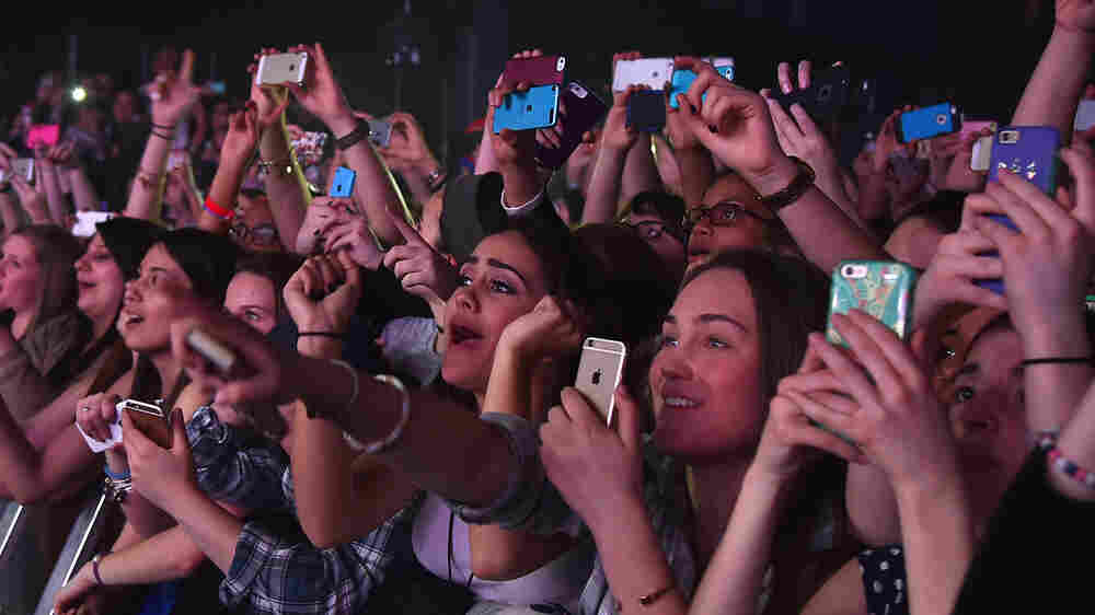 Lock Screen: At These Music Shows, Phones Go In A Pouch And Don't Come Out