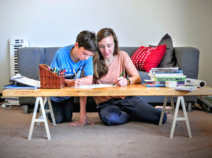 Natalie Dunnege and her son, Strazh, work on an art project at home in San Francisco. Her health insurance would cover therapy sessions to help with her depression, Dunnege says, but she hasn't been able to find a counselor who is taking new patients.