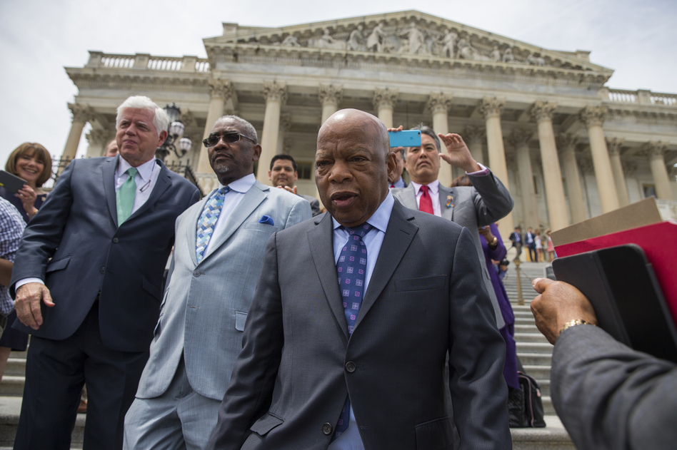 Rep. John Lewis, D-Ga., leads lawmakers down the steps of the Capitol to greet a crowd assembled after House Democrats ended their 26-hour-long sit-in protest on Thursday. (Evan Vucci/AP)