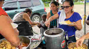 Cooking Chicken And Plantains For African Migrants In Costa Rica