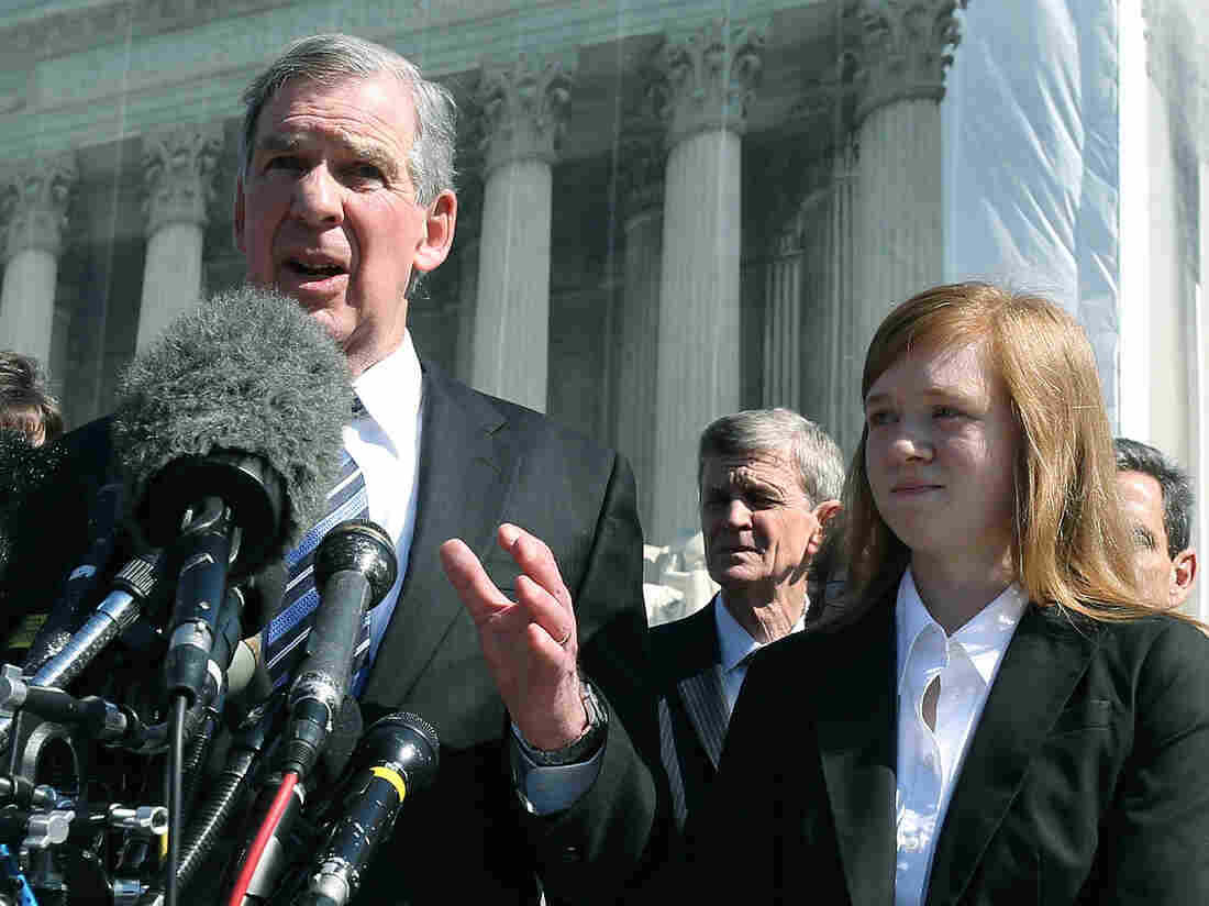 Attorney Bert Rein (L), speaks to the media while standing with plaintiff Abigail Noel Fisher (R), after the U.S. Supreme Court heard arguments in her caseon October 10, 2012 in Washington, DC. The high court heard oral arguments on Fisher V. University of Texas at Austin and are tasked with ruling on whether the university's consideration of race in admissions is constitutional.
