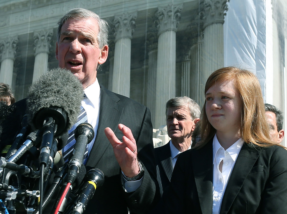 Attorney Bert Rein speaks to the media while standing with plaintiff Abigail Noel Fisher after the U.S. Supreme Court heard arguments in her case in 2012 in Washington, D.C. (Mark Wilson/Getty Images)