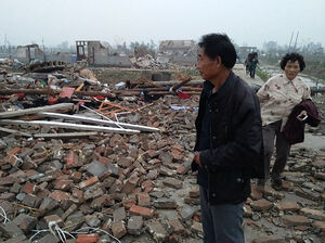 Residents look through the rubble of destroyed houses after a tornado in Yancheng, in China's Jiangsu province on Thursday.