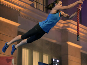 Intelligence officer Tory Garcia, who has a background in gymnastics and diving, works through the obstacle course on American Ninja Warrior, which airs on NBC and Esquire Network.