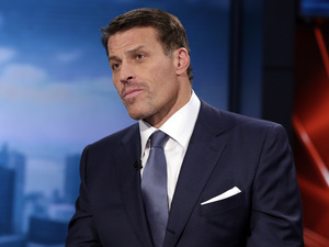 Motivational speaker Tony Robbins is interviewed on the Fox Business Network in March. Dozens of people were burned in a coal-walking exercise at one of his seminars.