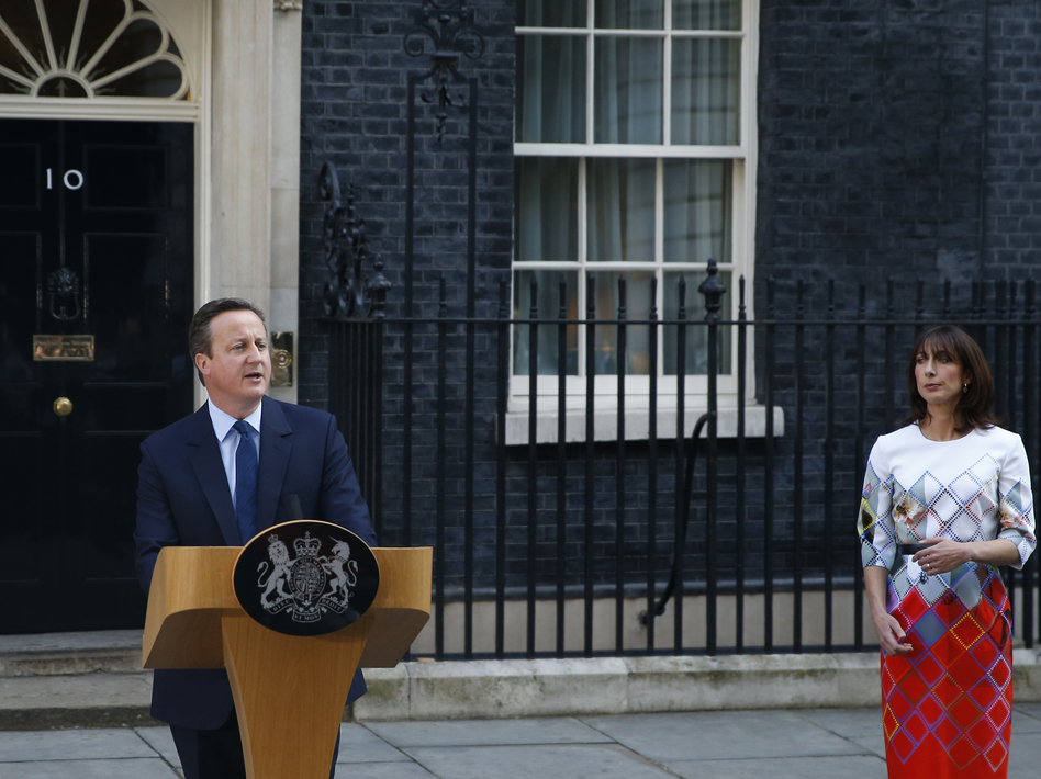 Britain's Prime Minister David Cameron, accompanied by his wife, Samantha, speaks to the media in front of 10 Downing St. on Friday as he announces his resignation following Britain's vote to leave the EU. (Alastair Grant/AP)