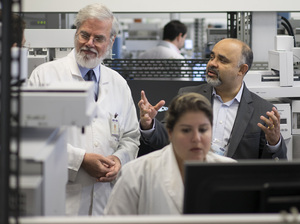 Sports Minister George Hilton (top right) visits the Brazilian Doping Control Laboratory in Rio de Janeiro last month. The lab, which had been set to test samples from Olympic athletes in August, has been suspended by the World Anti-Doping Agency.