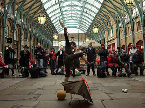 A juggler performs during an audition for a busking spot in the North Hall at Covent Garden Market.