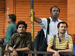 People watch stock prices on a digital broadcast outside the Bombay Stock Exchange on Friday. Currency, equity and oil markets around the world are feeling the effects of the British vote to leave the EU.