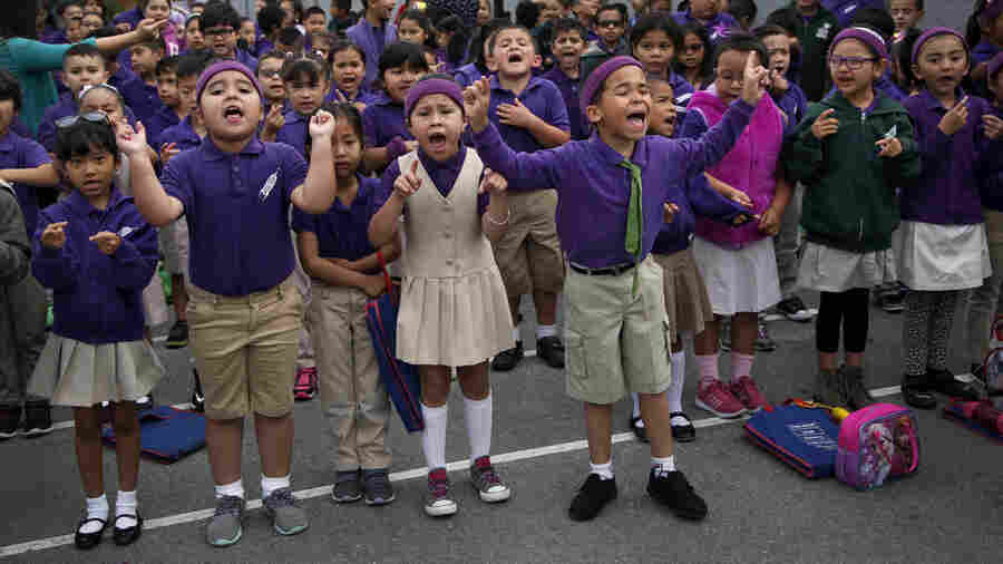 Students at Fuerza Community Prep, part of Rocketship Education charter schools, cheer during their daily morning assembly in San Jose, Calif.