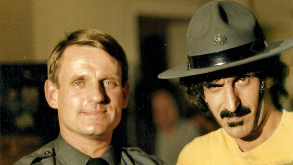 Zappa in 1981 with Pennsylvania state trooper Chuck Ash, who interviewed the musician during an anti-drug campaign run by the Montgomery County school district. (Sony Pictures Classics)