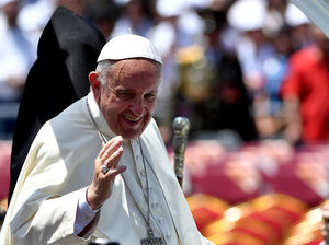 Pope Francis waves to the crowd from the popemobile after an open-air mass in Armenia's second-largest city of Gyumri on Saturday.