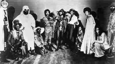 Bernie Worrell, Grady Thomas, Fuzzy Haskins, George Clinton, Tiki Fulwood, Michael Hampton, and Calvin Simon of Parliament-Funkadelic pose for a portrait in circa 1974.