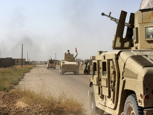 Iraqi forces advance in Fallujah, Iraq on Wednesday.