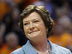 Former Tennessee women's basketball coach Pat Summitt smiles as a banner is raised in her honor before the team's NCAA college basketball game against Notre Dame in Knoxville, Tenn, in Jan. 2013.