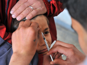 "A Syrian boy in a clinic in Aleppo receives an injection for the ""Aleppo button"" — one of the names used for the welts caused by leishmaniasis."