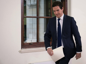 British Chancellor of the Exchequer George Osborne, the United Kingdom's head financial official, leaves after making a statement at the Treasury in London on Monday.