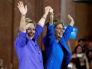 Democratic Presidential candidate Hillary Clinton, left, and Sen Elizabeth Warren wave to the crowd before a campaign rally at the Cincinnati Museum Center at Union Terminal on June 27.