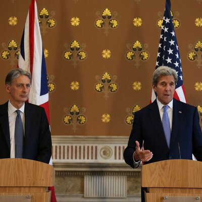 """British Foreign Secretary Philip Hammond (left) and U.S. Secretary of State John Kerry hold a joint press conference after meeting in London on Monday. The U.S. """"could not ask for a better friend and ally,"""" Kerry said."""