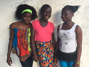 Evelyn Sokpo, 12, (left), Sankay Diallo, 13, (center) and Saran Kallay, 12