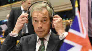 Nigel Farage, leader of the UKIP party, sits behind a British flag during a special session of European Parliament in Brussels on Tuesday.