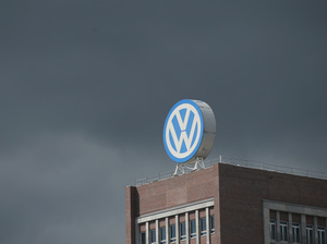 The logo of German automaker Volkswagen AG stands on an administrative building at the Volkswagen factory as a dark cloud passes behind on the day of the company's annual press conference on April 28, 2016 in Wolfsburg, Germany.
