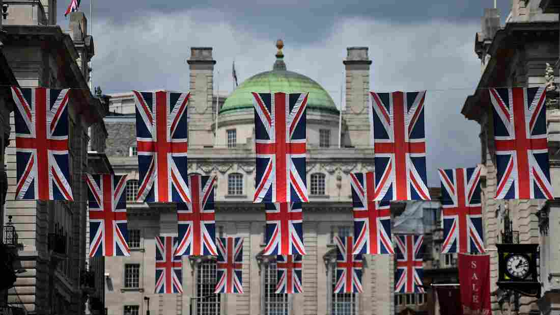 Union flags fly as banners across a street in central London on Tuesday. EU leaders attempted to rescue the European project and Prime Minister David Cameron sought to calm fears over the U.K.'s vote to leave the bloc as ratings agencies downgraded the country.