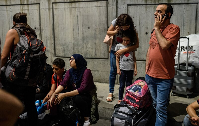 People wait outside the Ataturk airport in Istanbul after an attack on Tuesday that killed at least 28 people.