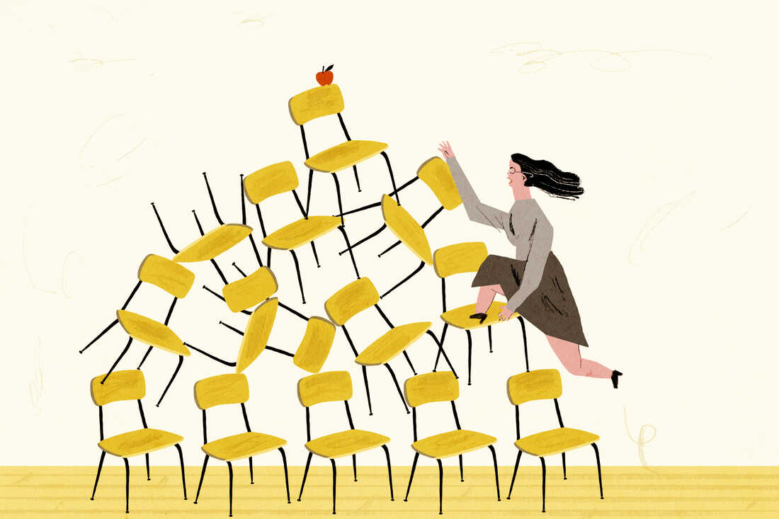 Teacher fighting her way to the top of a mountain of school chairs.