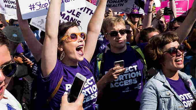 Abortion rights activists celebrate outside the U.S. Supreme Court Monday's ruling.