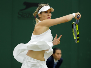Eugenie Bouchard of Canada returns to Magdalena Rybarikova of Slovakia. Bouchard says she likes the loose fit of the controversial NikeCourt Premier Slam dress.