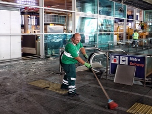Workers clean the debris from yesterday's blasts at Ataturk International Airport in Istanbul, Turkey, on Wednesday.