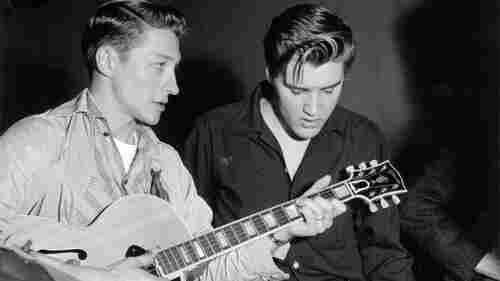 Guitarist Scotty Moore, left, helped define Elvis Presley's early sound. Moore died June 28.