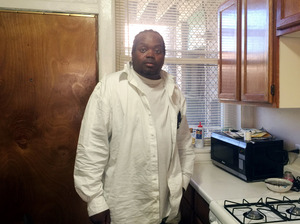 Glenn Baker, 44, stands in his Southside Chicago apartment that is paid for by a program of the University of Illinois Chicago hospital.