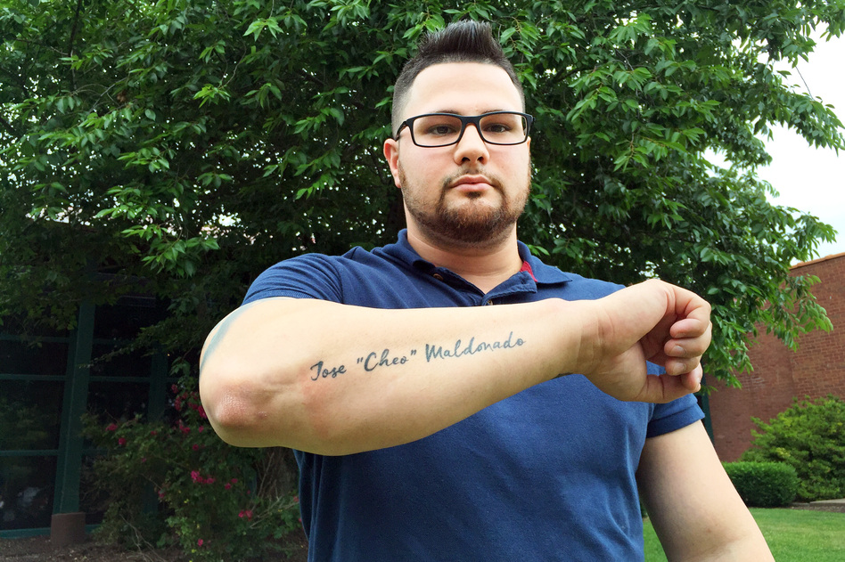 """Wilson Ramos got a tattoo of his brother's name, Jose """"Cheo"""" Maldonado, inked on his right forearm in memory of Maldonado, who died after a police officer shot him with a stun gun inside a jail cell in East Hartford, Conn. (Hansi Lo Wang/NPR)"""